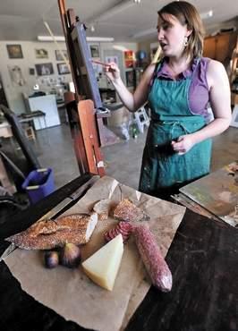 Artist Sarah Burns at work on a still life painting